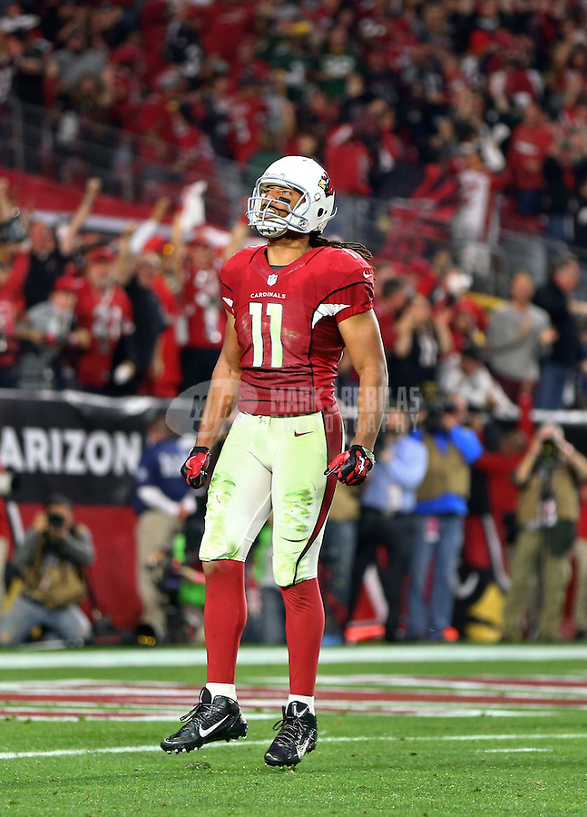 Jan 16, 2016; Glendale, AZ, USA; Arizona Cardinals wide receiver Larry Fitzgerald (11) reacts as he celebrates a play in overtime against the Green Bay Packers during an NFC Divisional round playoff game at University of Phoenix Stadium. Mandatory Credit: Mark J. Rebilas-USA TODAY Sports