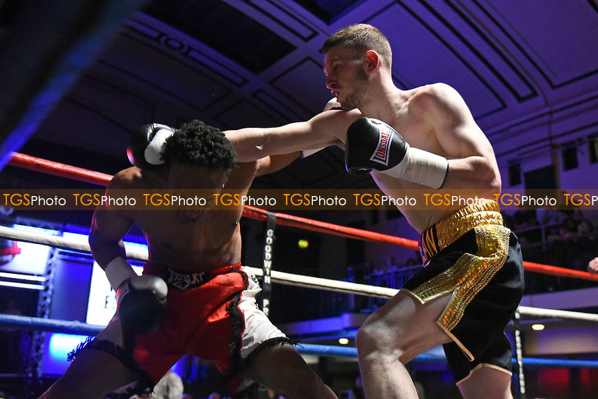 Sean Robinson (black/gold) shorts defeats Victor Edagha during a Boxing Show at York Hall on 11th March 2017