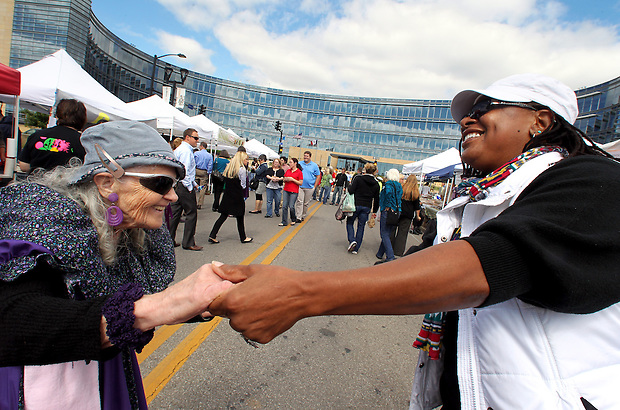 "Nellie west, left, of Altoona, and AJ Singleton of Des Moines enjoy an impromptu Polka dance together during  the midday Downtown Farmers' Market on September 21 in Des Moines.  West, a 75-year-old Polka enthusiast, beckoned the passing Singleton, who happily joined her as music supplied by the Polka Club of Iowa played.  ""I don't know anybody who doesn't smile when they are around Polka music,"" West said."