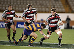 Kristian Ormsby has the support of Andrew Van der Heijden & Sekope Kepu as Ben Castle attempts to tackle him during the Air NZ Cup rugby game between Bay of Plenty & Counties Manukau played at Blue Chip Stadium, Mt Maunganui on 16th of September, 2006. Bay of Plenty won 38 - 11.