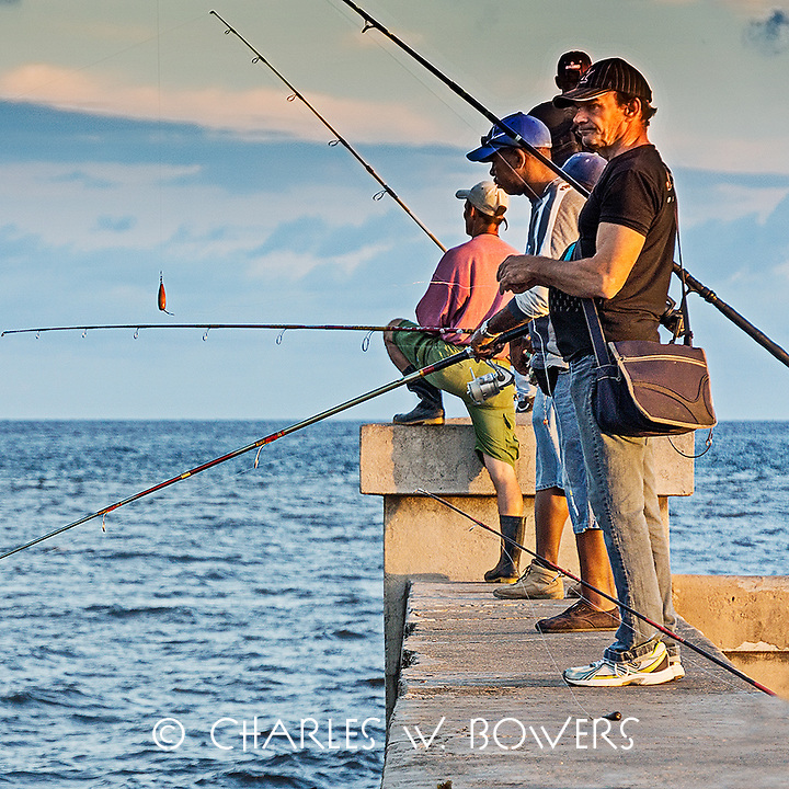 Faces Of Cuba - Fishing in the early morning at the harbor<br />