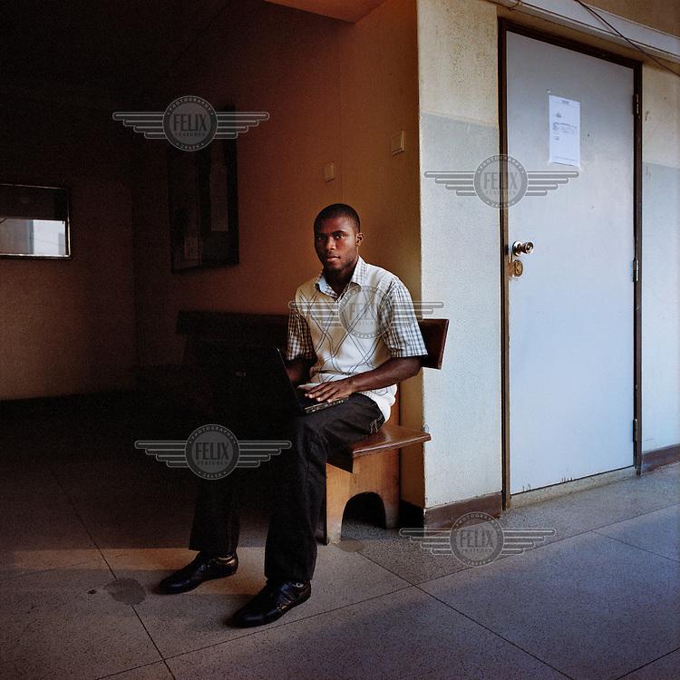 21-year-old Simao Matondo uses a laptop computer at the Agostinho Neto University (Universidade Agostinho Neto)..