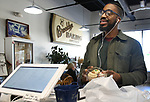 WATERBURY CT. 11 December 2018-121018SV03-Anthony Edwards of Windsor had to stop by the Brooklyn Baking Company for a few cupcakes before heading home in Waterbury Tuesday.<br /> Steven Valenti Republican-American