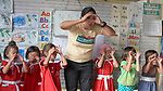 Christian Love Daroy-Gagno, the program director of the Kapatiran-Kaunlaran Foundation (KKFI), sings and acts out a song with children in a KKFI-sponsored preschool in Pulilan, a village in Bulacan, Philippines.<br /> <br /> KKFI is supported by United Methodist Women.