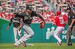 28 September 2014: Miami Marlins starting pitcher Henderson Alvarez makes a throw to first for the out against the Washington Nationals for the last game of the regular season at Nationals Park in Washington, DC. The Nationals shut out the Marlins with a 1-0 no-hitter going to Nationals pitcher Jordan Zimmermann. Mandatory Credit: Ed Wolfstein Photo *** RAW (NEF) Image File Available ***