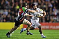 Manu Tuilagi looks to fend Tim Molenaar. Aviva Premiership match, between Harlequins and Leicester Tigers on April 18, 2014 at the Twickenham Stoop in London, England. Photo by: Patrick Khachfe / JMP