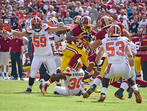 Washington Redskins running back Matt Jones (31) carries the ball early in the first quarter against the Cleveland Browns at FedEx Field in Landover, Maryland on October 2, 2016.  Defending on the play are Cleveland Browns inside linebacker Tank Carder (59), free safety Derrick Kindred (30), and outside linebacker Joe Schobert (53).<br /> Credit: Ron Sachs / CNP