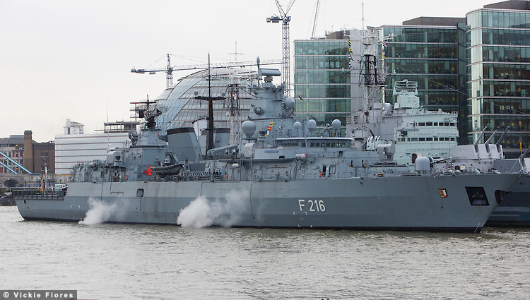 German frigate FGS Schleswig-Holstein F216 arrives in London under Tower Bridge at 6:50am on Friday 24 January 2014 and takes a temporary berth next to HMS Belfast. FGS Schleswig-Holstein is a Type 123, Brandenburg-class frigate belonging to the German Navy and measures 139 meters in length.