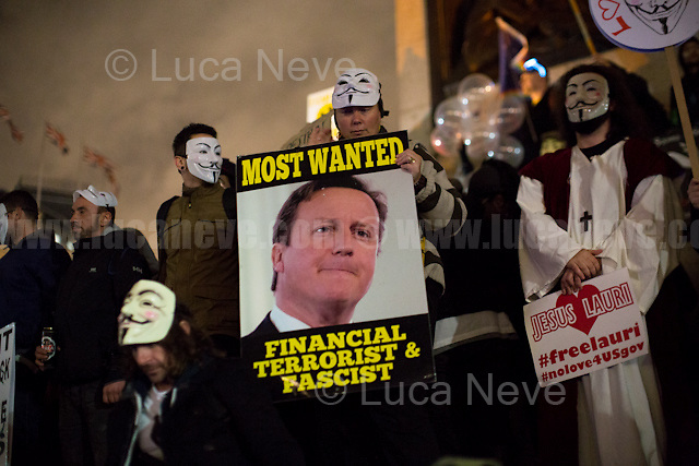 London, 05/11/2016. Thousands of protesters gathered this evening in central London to take part in a demonstration called the &quot;Million Mask March&quot;, which is organised annually by Anonymous, and held globally in more than 400 cities planned to coincide with Guy Fawkes Night (The Gunpowder Plot of 1605). The aim of the demo was to highlight social injustice and Government corruption across the globe, but also to protect the environment, freedom of the internet, oppose mass surveillance and austerity. The rally started in Trafalgar Square. Consequently, protesters marched on Whitehall, gathering in Parliament Square. Then, the demonstration carried on towards Buckingham Palace and The Mall, to end in the Trafalgar Square area, where a heavy police presence in full riot gears contained the last activists in few &quot;kettle&quot; arresting 47 people. <br /> <br /> For more information please click here: https://www.facebook.com/events/485894658146587/