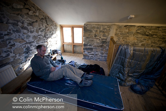 Nicholas Roe making notes on his bed inside the barn at Low Bridge End farm in St. John's-in-the-Vale, Cumbria which provided overnight accommodation during his walking tour of the Lake District. Camping in barns was an initiative started by Cumbrian farmers looking to diversify their businesses and to provide additional facilities for fell walkers and visitors to the Lake District. The Lake District, also known as The Lakes or Lakeland, was a rural area in North West England and popular holiday destination, famous for its lakes and its mountains (or fells) and its associations with the early 19th century poetry and writings of William Wordsworth and the Lake Poets. The central and most-visited part of the area is contained in the Lake District National Park ? one of fourteen National parks in the United Kingdom.