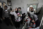 Palestinians inside their house, as it is attacked by rioting Jewish settler youth, after the army evicted settlers from a disputed building in Hebron, West Bank.<br />
