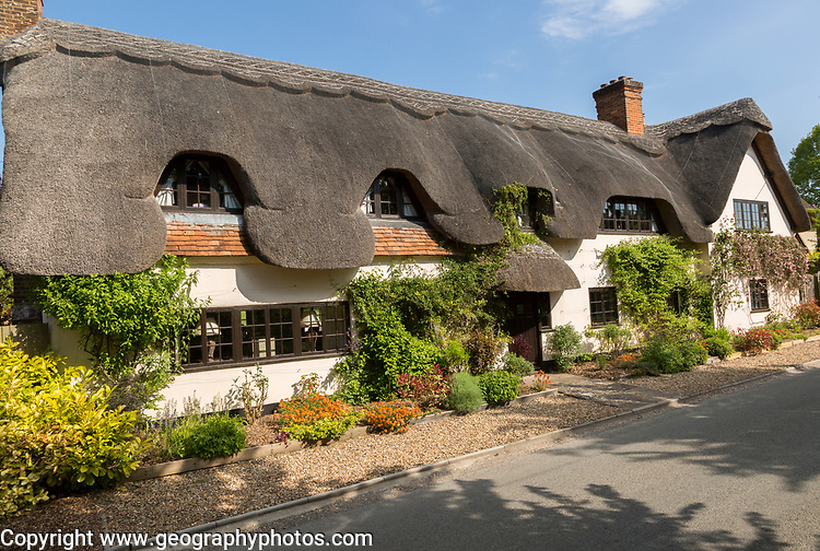 Attractive traditional thatched cottage at West Amesbury, Woodford Valley, Wiltshire, England, UK