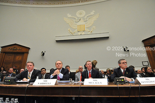 "Washington, DC - December 5, 2008 -- United States House Financial Services Committee hearing ""On review of industry plans to stabilize the financial condition of the American automobile industry"" witnesses (from left to right) Richard Wagoner, Chairman and Chief Executive Officer, General Motors Corporation; Robert Nardelli, Chief Executive Officer, Chrysler, LLC; Alan Mulally, President and Chief Executive Officer, Ford Motor Company; Ron Gettelfinger, President, United Auto Workers; in Washington, D.C. on Friday, December 5, 2008.  The automotive industry leaders requested $35 billion in loans from Congress to insure their respective company's survival..Credit: Ron Sachs / CNP"