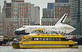 Riders onboard a New York Water Taxi get a close-up view of the space shuttle Enterprise as it is towed by barge up the Hudson River on it's way to the Intrepid Sea, Air and Space Museum where it will be permanently displayed, Wednesday, June 6, 2012 in New York City. .Mandatory Credit: Bill Ingalls / NASA via CNP