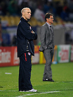 USA manager Bob Bradley stands in front of Fabio Capello manager of England. USA vs England in the 2010 FIFA World Cup at Royal Bafokeng Stadium in Rustenburg, South Africa on June 12, 2010.