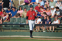Kannapolis Intimidators coach Ryan Johansen (21) coaches first base during the game against the Rome Braves at Kannapolis Intimidators Stadium on July 3, 2019 in Kannapolis, North Carolina.  The Braves defeated the Intimidators 13-11, (Brian Westerholt/Four Seam Images)