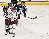Zackary MacQueen (StFX - 21), Brendan Silk (BC - 9), Brad Cuzner (StFX - 17) - The Boston College Eagles defeated the visiting St. Francis Xavier University X-Men 8-2 in an exhibition game on Sunday, October 6, 2013, at Kelley Rink in Conte Forum in Chestnut Hill, Massachusetts.