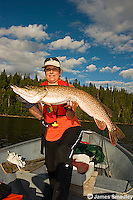 Woman holding a huge northern pike