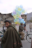 Kabul, Afghanistan<br /> November 2001<br /> <br /> The ruins of Kabul from decades of war in Afghanistan between several warring fractions. Balloons are sold for the first time after the Northern Alliance defeated the Taliban - who did not allow balloons during their rule.