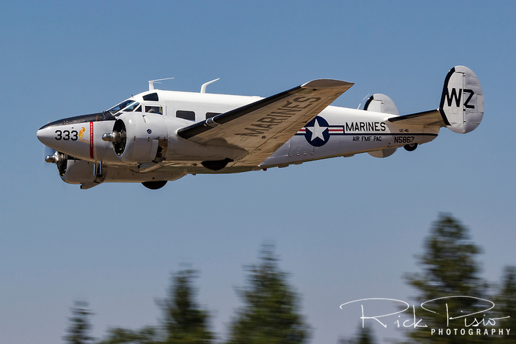 Beech 18, N5867, in Marines livery in flight over Grass Valley, CA.