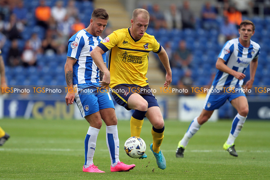 Neil Bishop of Scunthorpe United gets the ball from George Moncur of Colchester United during Colchester United vs Scunthorpe United, Sky Bet League 1 Football at the Weston Homes Community Stadium, Colchester, England on 29/08/2015