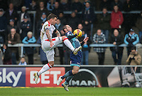 Michael Harriman of Wycombe Wanderers controls the ball under pressure from James Collins of Crawley Town during the Sky Bet League 2 match between Wycombe Wanderers and Crawley Town at Adams Park, High Wycombe, England on 25 February 2017. Photo by Andy Rowland / PRiME Media Images.