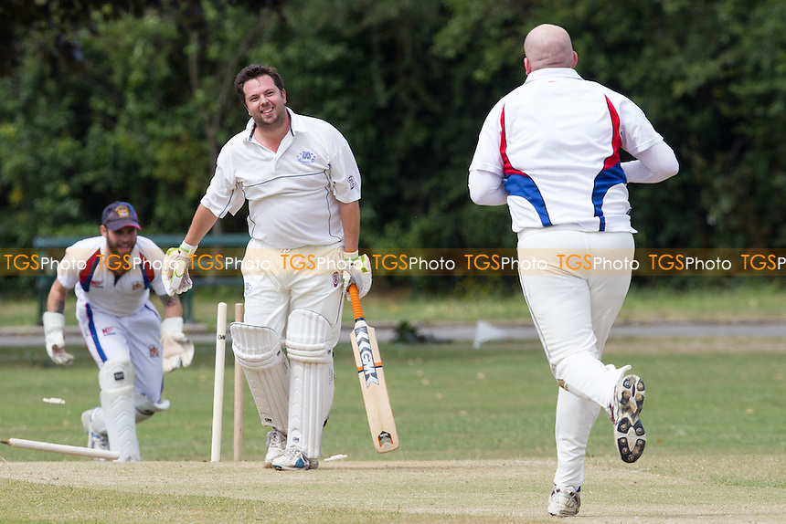 Whittaker of Hornchurch flattens Sims off stump - Hornchurch Athletic CC 2nd XI vs Brookweald CC - Mid-Essex Cricket League at Hylands Park - 05/07/14 - MANDATORY CREDIT: TGSPHOTO - Self billing applies where appropriate - 0845 094 6026 - contact@tgsphoto.co.uk - NO UNPAID USE