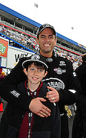 Sept. 18, 2011; Concord, NC, USA: NHRA top fuel dragster driver Larry Dixon with son Donovan Dixon during the O'Reilly Auto Parts Nationals at zMax Dragway. Mandatory Credit: Mark J. Rebilas-