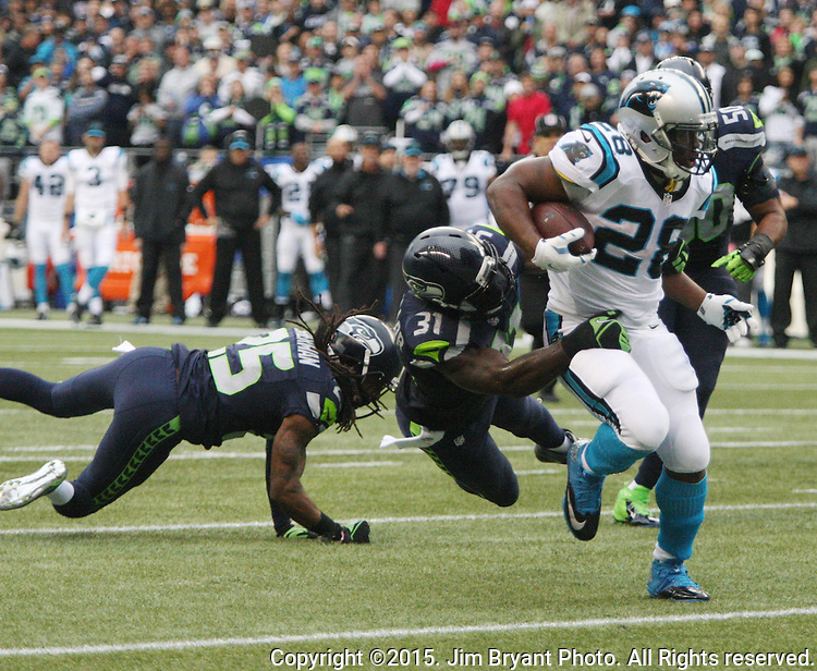 Carolina Panthers running back Jonathan Stewart (28) powers his way past Seattle Seahawks  strong safety Kam Chancellor (31) for a touchdown at CenturyLink Field in Seattle on October 18, 2015. The Panthers came from behind with 32 seconds remaining in the 4th Quarter to beat the Seahawks 27-23.  ©2015 Jim Bryant Photography. All Rights Reserved.