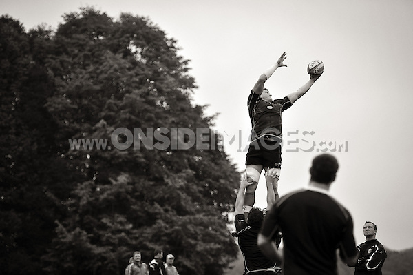 Stuart Hooper wins lineout ball. Bath Rugby training session on October 25, 2012 at Farleigh House in Bath, England. Photo by: Patrick Khachfe/Onside Images