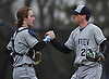 Mark Faello #22, Plainview JFK pitcher, right, gets congratulated by battery mate Michael Cole #6 after pitching a shutout in a Nassau County varsity baseball game against host East Meadow High School on Thursday, March 30, 2017. Faello struck out seven batters in Plainview JFK's 4-0 win.