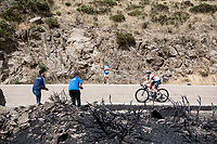Valerio Conti (ITA/UAE-Emirates) up the Puerto de la Morcuera, riding through a stretch that was hit by some wildfire not too long before<br /> <br /> Stage 18: Colmenar Viejo to Becerril de la Sierra (178km)<br /> La Vuelta 2019<br /> <br /> ©kramon