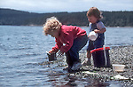 Puget Sound, kids at the beach, Spencer Spit State Park, Washington State, Pacific Northwest, USA,