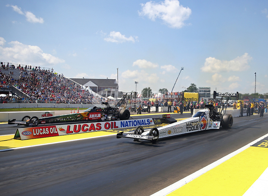 Aug 19, 2017; Brainerd, MN, USA; NHRA top fuel driver Antron Brown (near) races alongside Terry McMillen during qualifying for the Lucas Oil Nationals at Brainerd International Raceway. Mandatory Credit: Mark J. Rebilas-USA TODAY Sports