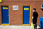 The referee's assistant waiting for the visiting team to emerge from their dressing room before Warrington Town played King's Lynn Town in the Northern Premier League premier division super play-off final tie at Cantilever Park, Warrington. The one-off match was between the winners of play-off matches in the Northern Premier League and the Southern League Premier Division Central to determine who would be promoted to the National League North. The visitors from Norfolk won 3-2 after extra-time, watched by a near-capacity crowd of 2,200.