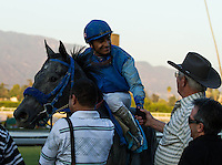 Rafael Bejarano and trainer of Tilde, Mike Harrinton winners of the Keith E. Card Cal Cup Juvenile Fillies at Santa Anita Park in Arcadia, California on October 13, 2012.