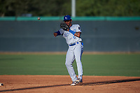 AZL Royals second baseman Herard Gonzalez (2) throws to first base during an Arizona League game against the AZL White Sox at Camelback Ranch on June 19, 2019 in Glendale, Arizona. AZL White Sox defeated AZL Royals 4-2. (Zachary Lucy/Four Seam Images)