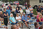 A mix of residents, press, fire-fighters, and government officials listen to other officials at a public information meeting held at the high school in Pateros, Washington on August 21, 2015  during wild fires.