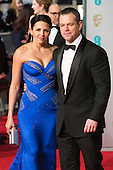 London, UK. 14 February 2016. Actor Matt Damon with wife Luciana Barroso. Red carpet arrivals for the 69th EE British Academy Film Awards, BAFTAs, at the Royal Opera House. © Vibrant Pictures/Alamy Live News