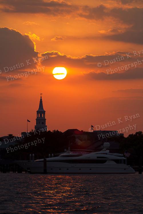 Sunset over St Michaels Church and Mega Yacht Muse on the Charleston Harbor South Carolina