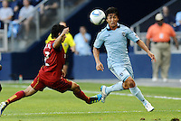 Roger Espinoza (pale blue) Sporting KC keeps his eyes on the ball despite the challenge of Real Salt Lake defender Tony Beltran... Sporting KC defeated Real Salt Lake 2-0 at LIVESTRONG Sporting Park, Kansas City, Kansas.