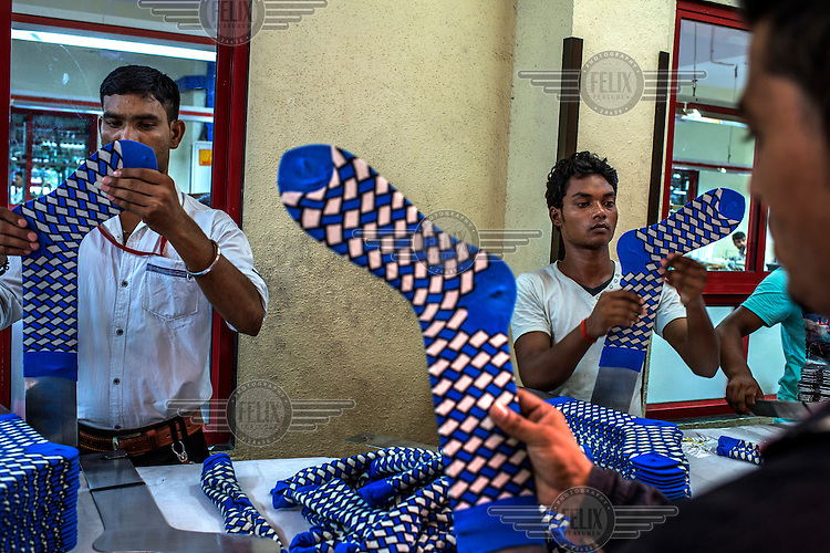 Workers at the Mustang Socks Factory.