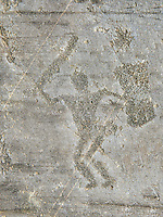 Petroglyph, rock carving, of a warrior with a sword and a square shiled. Carved by the ancient Camuni people in the iron age between 1000-1600 BC. Rock no 24,  Foppi di Nadro, Riserva Naturale Incisioni Rupestri di Ceto, Cimbergo e Paspardo, Capo di Ponti, Valcamonica (Val Camonica), Lombardy plain, Italy