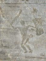 Petroglyph, rock carving, of a warrior with a sword and a square shiled. Carved by the ancient Camuni people in the iron age between 1000-1600 BC. Rock no 24,  Foppi di Nadro, Riserva Naturale Incisioni Rupestri di Ceto, Cimbergo e Paspardo, Capo di Ponti, Valcamonica (Val Camonica), Lombardy plain, Italy