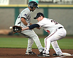 Tuscon Padres' Pedro Feliz beats a pick off throw to first against Reno Aces' Andy Tracy during a minor league baseball game in Reno, Nev., on Saturday, Sept. 3, 2011. The Padres won 6-5 in 11 innings..Photo by Cathleen Allison