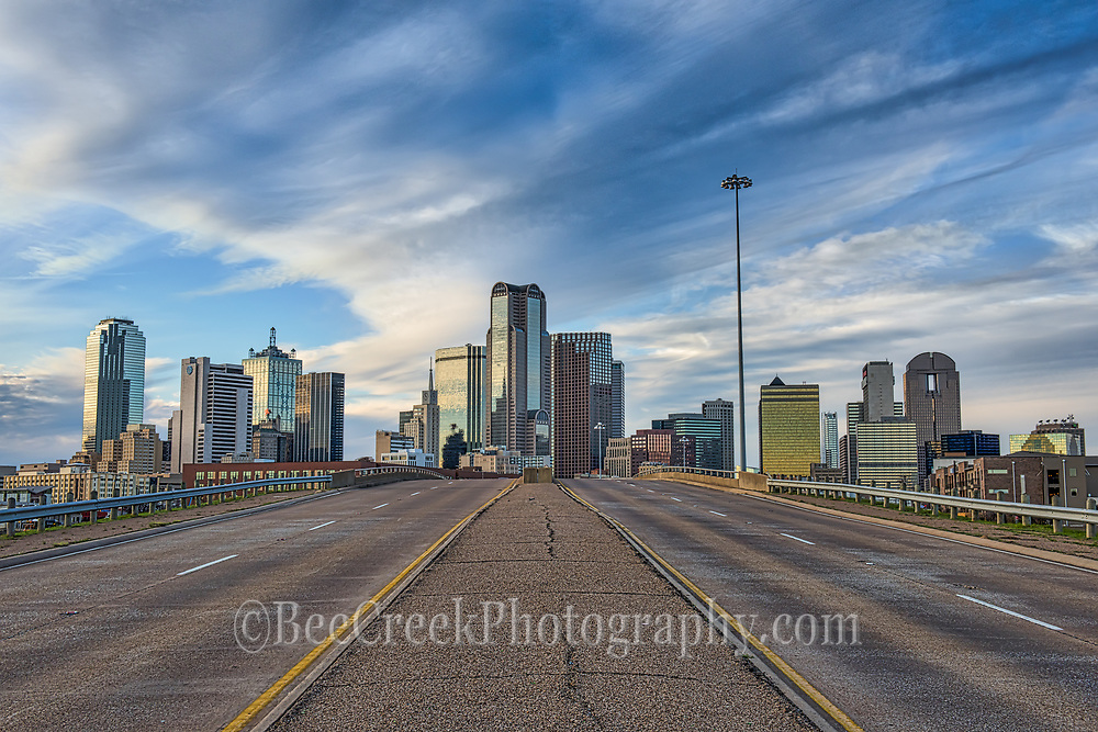 Dallas downtown skyline at dusk from a slightly different angle of the city. On the far left you can see the Reunion Tower and the Omni Hotel then right in the middle are the traditional buildings like Fountain Plaza, Bank of America, Chase Tower, Comerica,