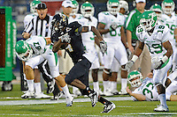 1 September 2011:  FIU's T.Y. Hilton (4) is pursued by North Texas' Freddie Warner (19) during the opening kickoff return as the FIU Golden Panthers defeated the University of North Texas, 41-16, at University Park Stadium in Miami, Florida.