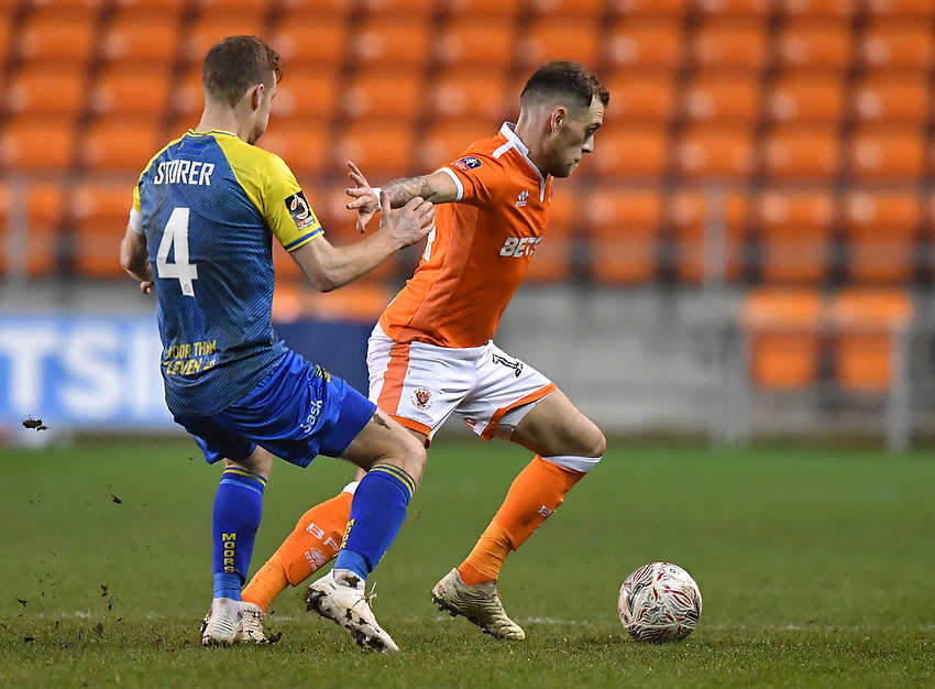 Blackpool's Harry Pritchard battles with Solihull Moors' Kyle Storer<br /> <br /> Photographer Dave Howarth/CameraSport<br /> <br /> The Emirates FA Cup Second Round Replay - Blackpool v Solihull Moors - Tuesday 18th December 2018 - Bloomfield Road - Blackpool<br />  <br /> World Copyright © 2018 CameraSport. All rights reserved. 43 Linden Ave. Countesthorpe. Leicester. England. LE8 5PG - Tel: +44 (0) 116 277 4147 - admin@camerasport.com - www.camerasport.com