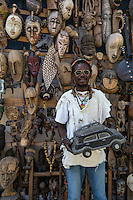 Dakar, Senegal.  Vendor of Carved African Masks, for sale as Souvenirs.