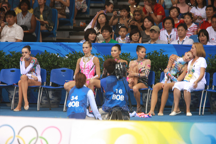 August 23, 2008; Beijing, China; (R) Rhythmic gymnast Inna Zhukova  of Belarus with coach feels the relief and happiness of winning silver in the All-Around final at 2008 Beijing Olympics. Others present are (L-R) Anna Bessonova of Ukraine, Olga Kapranova of Russia, Aliya Yussupova of Kazakhstan, Simona Peycheva of Bulgaria..(©) Copyright 2008 Tom Theobald